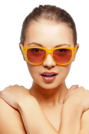 bright closeup portrait picture of teenage girl in shades photo