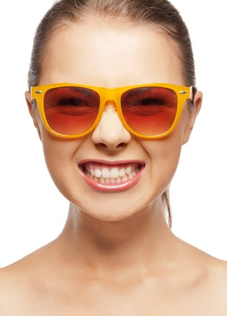 mocking: bright closeup portrait picture of funny teenage girl in shades