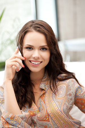 bright picture of businesswoman with cell phone photo