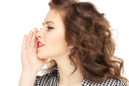 hearsay: bright picture of young woman whispering gossip Stock Photo