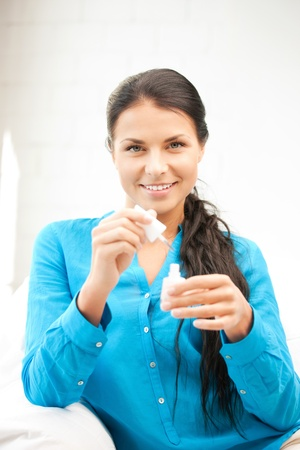 .picture of beautiful woman polishing her nails. .