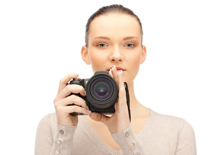 picture of calm teenage girl with digital camera photo