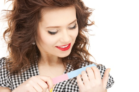 .picture of beautiful woman polishing her nails. . Stock Photo - 21278375