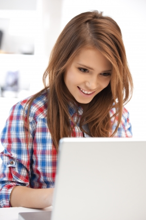 girl with laptop: picture of happy woman with laptop computer Stock Photo