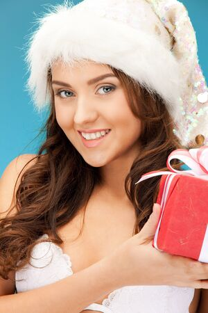 picture of cheerful santa helper girl with gift box Stock Photo - 11328929