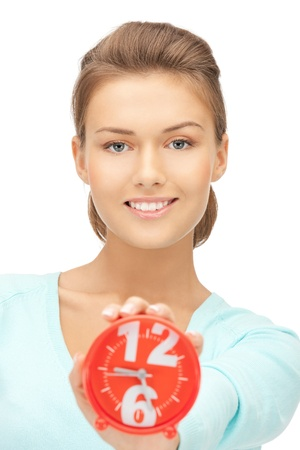 bright picture of woman holding alarm clock photo