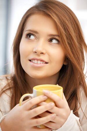 bright picture of lovely woman with mug Stock Photo - 11508490