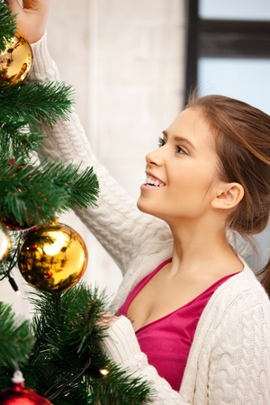 decorating christmas tree: bright picture of woman decorating christmas tree Stock Photo