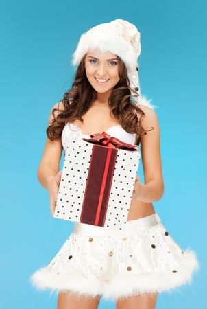 picture of cheerful santa helper girl in lingerie with gift box photo