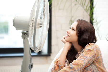 picture of happy woman with big fan photo