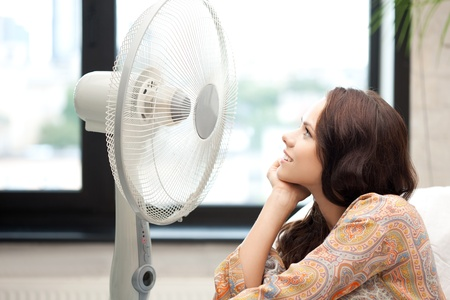 picture of happy woman with big fan Stock Photo