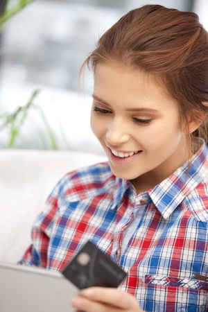 picture of happy woman with laptop computer and credit card Stock Photo - 11668442
