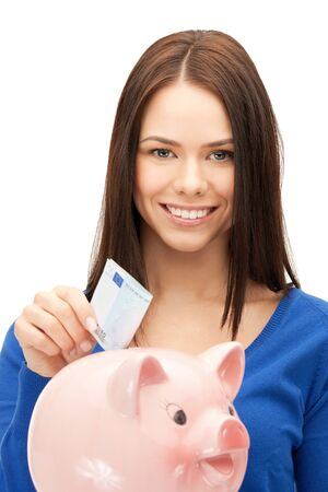 picture of lovely woman with piggy bank and money. photo