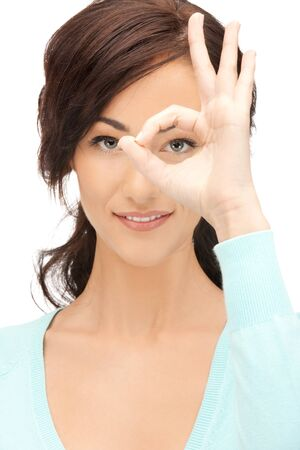 vision concept: picture of lovely woman looking through hole from fingers