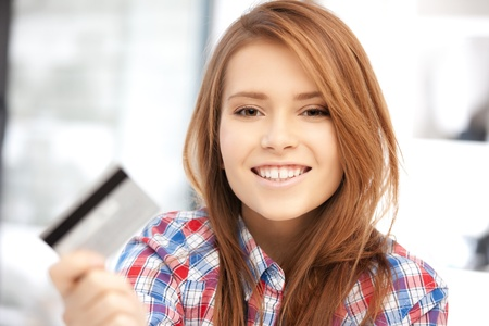 spending: bright picture of happy woman with credit card