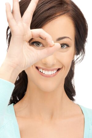 picture of lovely woman looking through hole from fingers photo