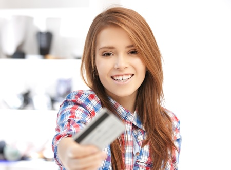 paying: bright picture of happy woman with credit card