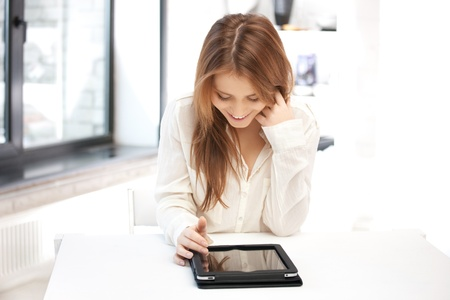 portable: picture of happy woman with tablet pc computer