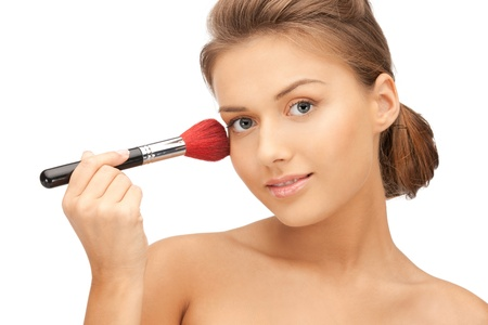 make up brush: bright closeup portrait picture of beautiful woman with brush Stock Photo
