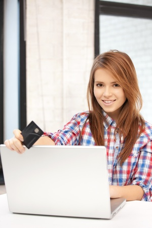 picture of happy woman with laptop computer and credit card Stock Photo - 12179597