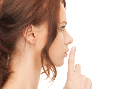 bright picture of young woman with finger on lips Stock Photo - 12361915