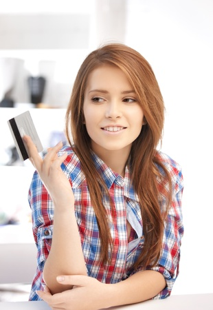 bright picture of pensive woman with credit card Stock Photo - 12361928