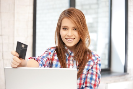 picture of happy woman with laptop computer and credit card Stock Photo - 12362154