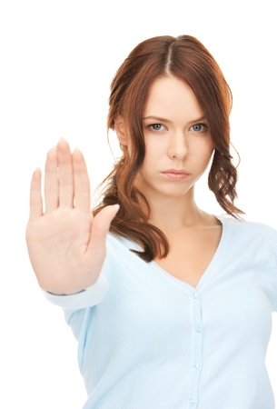 miserable: bright picture of young woman making stop gesture Stock Photo