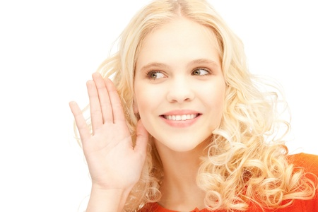 hearsay: bright picture of young woman listening gossip Stock Photo