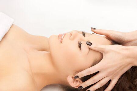picture of beautiful woman in massage salon photo