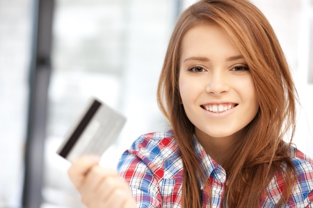 credit card purchase: bright picture of happy woman with credit card
