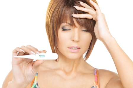 bright picture of unhappy woman with thermometer Stock Photo - 12362336