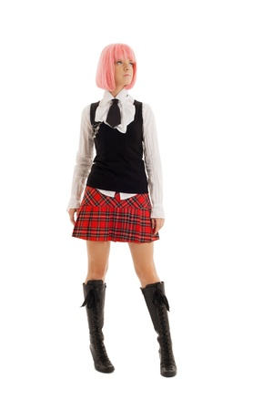 checkered skirt: pin-up image of lovely schoolgirl with pink hair Stock Photo