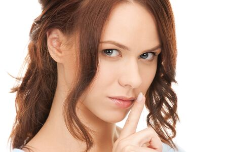 bright picture of young woman with finger on lips Stock Photo - 12376805