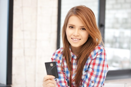 bright picture of happy woman with credit card Stock Photo - 12376812