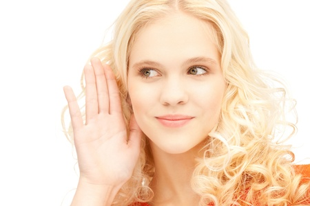 tattle: bright picture of young woman listening gossip Stock Photo