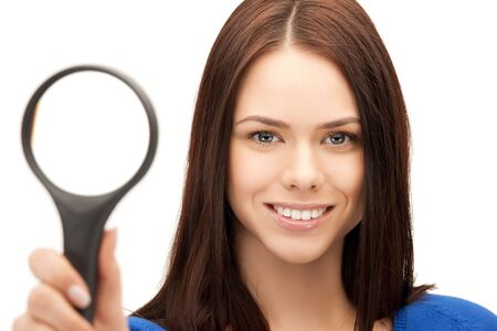 picture of beautiful woman with magnifying glass photo