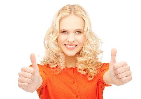 bright picture of lovely teenage girl with thumbs up photo