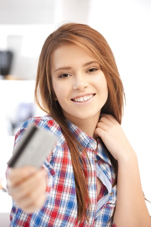 bright picture of happy woman with credit card photo