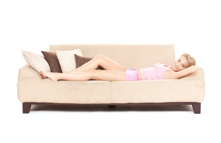 bright picture of happy woman on sofa photo