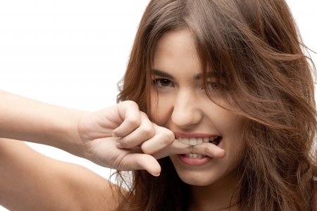 closeup portrait picture of woman biting her finger