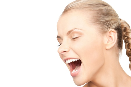 desperate face: bright closeup picture of unhappy screaming woman Stock Photo
