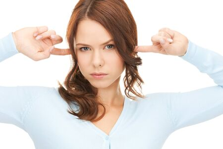 depressed girl: picture of woman with fingers in ears  Stock Photo