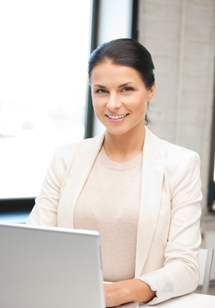 remote access: picture of happy woman with laptop computer