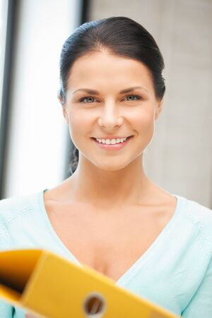 bright picture of beautiful woman with folder Stock Photo - 12629889