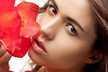 picture of lovely woman with red flowers photo