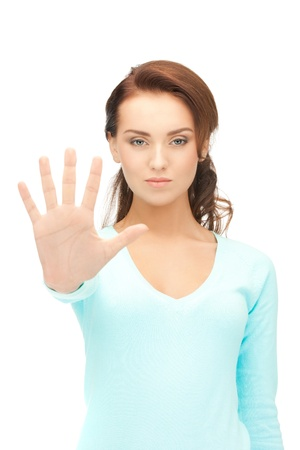 veto: bright picture of young woman making stop gesture Stock Photo