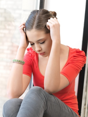 depressed woman: bright indoors picture of calm teenage girl