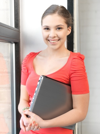 bright picture of happy and smiling teenage girl with laptop Stock Photo - 12658724