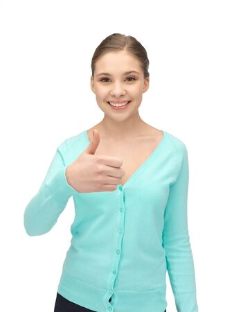bright picture of lovely teenage girl with thumbs up Stock Photo - 12658689